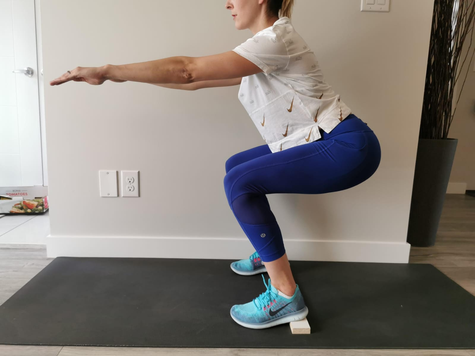 Feet Elevated Squats - Improve Your Squats